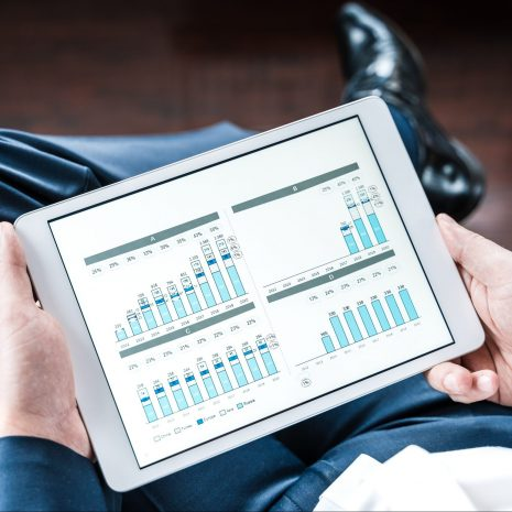 Working businessman,investor,trader.Financial report,presenatation in tablet.Diagram,gantt chart, analytics,project profit evaluation.Business meeting,negotiations.CEO,general manager.Bank investment